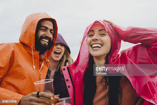 rainy festival days - hood clothing stock photos and pictures