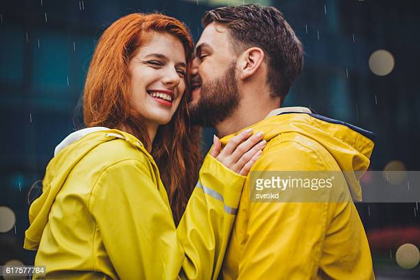 rainy kiss - couples kissing shower stock pictures, royalty-free photos & images