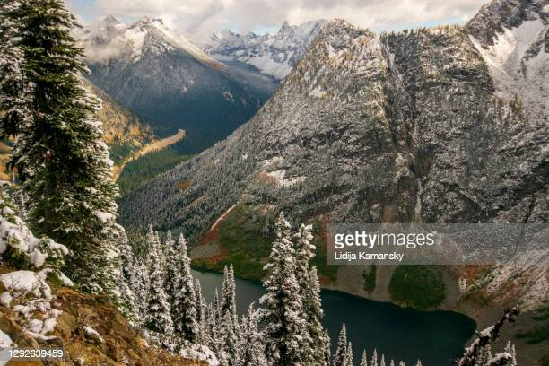 rainy lake and snowy mountains - national forest stock pictures, royalty-free photos & images