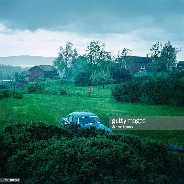 rainy landscape with car parked - レクサンド ストックフォトと画像