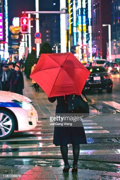 雨の夜 銀座8丁目 - 商業地域 ストックフォトと画像