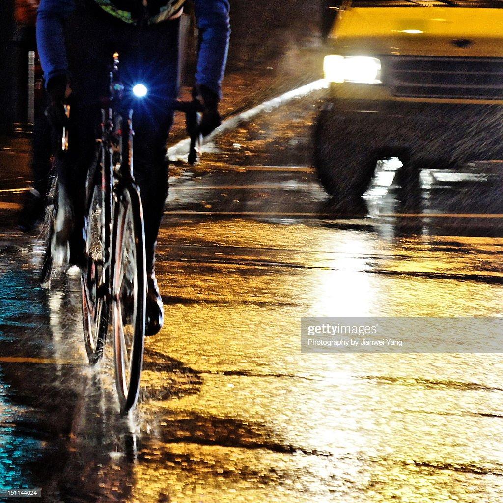 Rainy night rider : Stock Photo