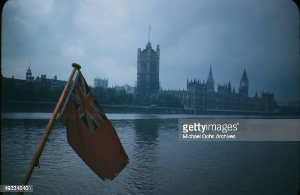 A rainy night view of the Parliament building taken from the Thames River boat in London England in June 1946