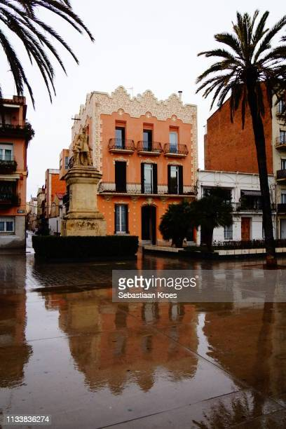 Rainy Passeig de la Rambla, Statue Roca Pi, Badalona, Spain