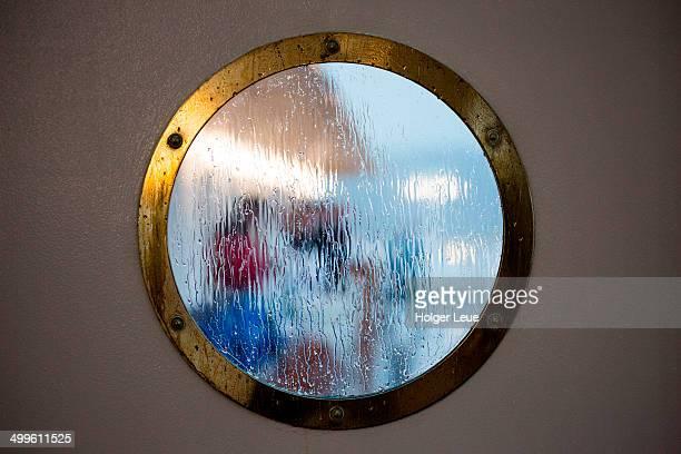 Rainy porthole window view