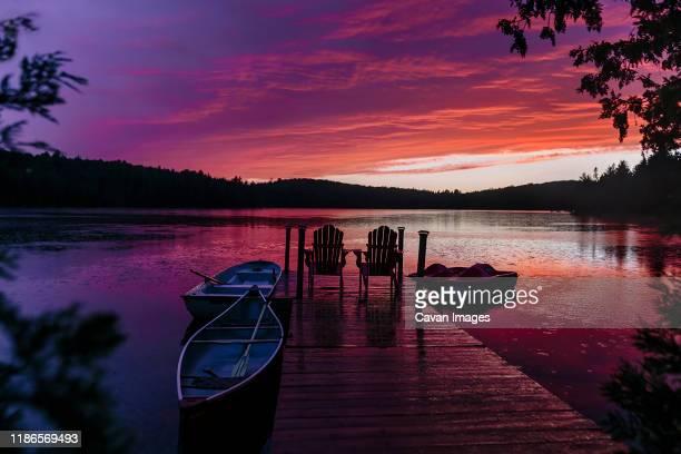 rainy purple summer sunset at the dock - embarcadero fotografías e imágenes de stock