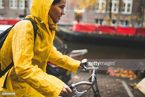 rainy ride - rain stockfoto's en -beelden