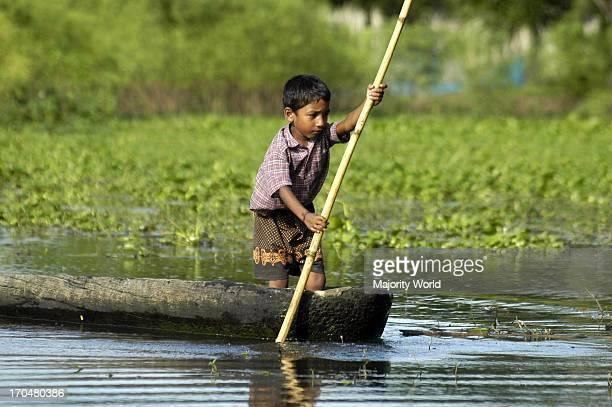 Rainy Season A child on a dinghy Kaliganj in Gazipur Bangladesh August 28 2007