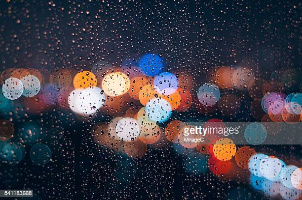 Rainy Wet Window Glass with Light Bokeh