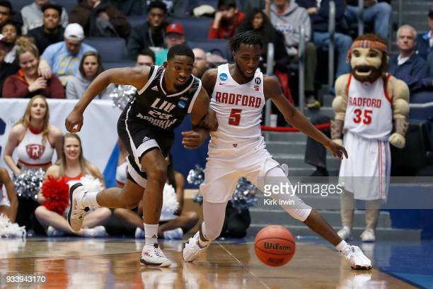 Raiquan Clark of the LIU Brooklyn Blackbirds and Donald Hicks of the Radford Highlanders chase after a loose ball during the game at UD Arena on...
