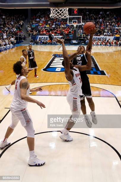 Raiquan Clark of the LIU Brooklyn Blackbirds shoots the ball over the defense of Ed Polite Jr #24 of the Radford Highlanders during the game at UD...