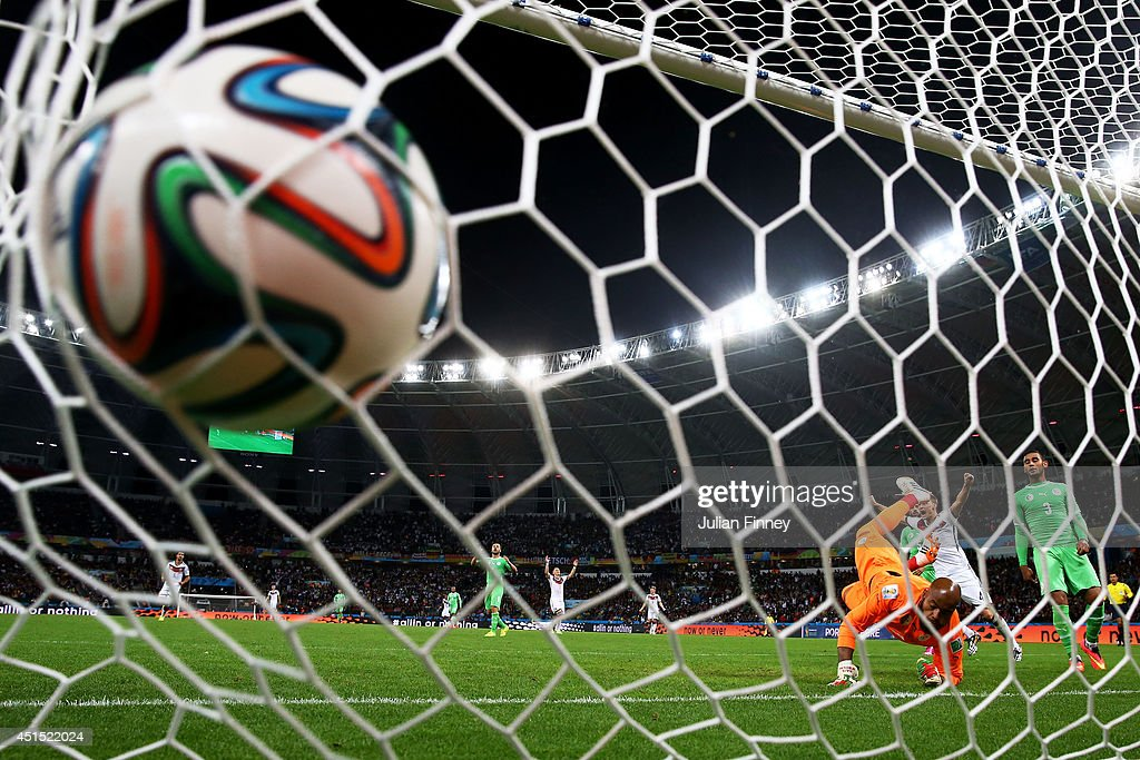 Rais M'Bolhi of Algeria fails to save a shot by Andre Schuerrle of Germany (not pictured) for Germany's first goal in extra time during the 2014 FIFA World Cup Brazil Round of 16 match between Germany and Algeria at Estadio Beira-Rio on June 30, 2014 in Porto Alegre, Brazil.