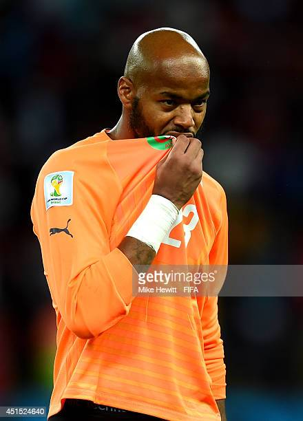 Rais M'Bolhi of Algeria reacts after the 12 defeat in the 2014 FIFA World Cup Brazil Round of 16 match between Germany and Algeria at Estadio...