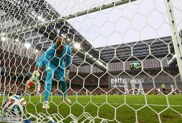 Rais M'Bolhi of Algeria retrieves the ball from the net after a goal by Russia during the 2014 FIFA World Cup Brazil Group H match between Algeria...