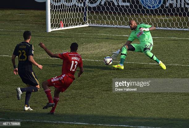 Rais Mbolhi of Philadelphia Union is unable to make the save on a shot and goal by Tesho Akindele of FC Dallas at PPL Park on March 21 2015 in...