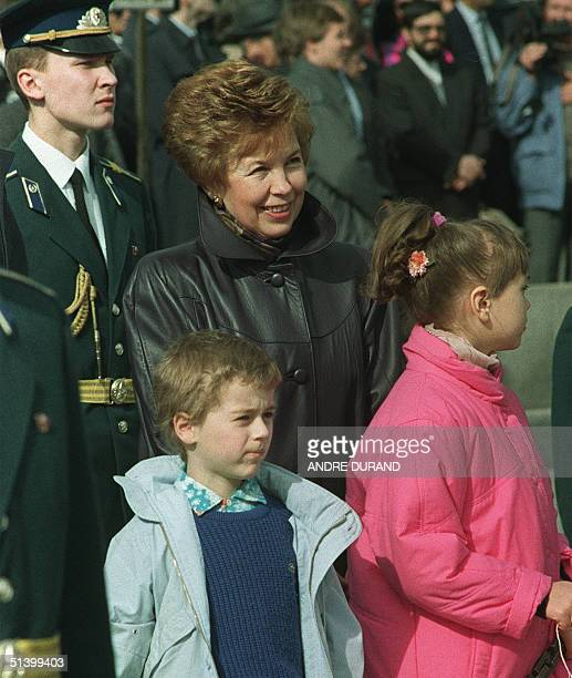 Raisa Gorbachev wife of Soviet President Mikhail Gorbachev attends with two unidentified children 01 May 1990 in front of the rostrum of the Lenin's...
