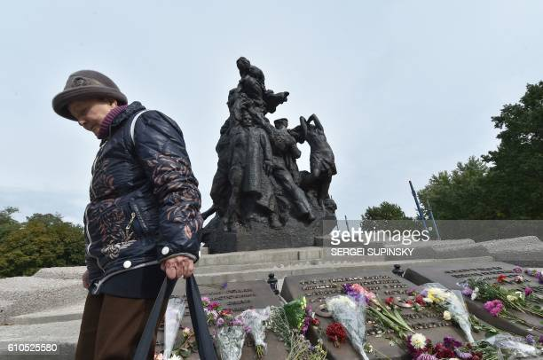 Raisa Maistrenko reacts during a visit to the Babi Yar monument in Kiev on September 23 2016 a few days before Ukraine marks the 75th anniversary of...