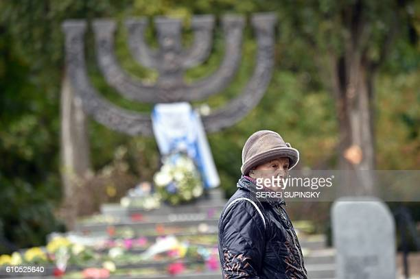 Raisa Maistrenko reacts during a visit to the Babi Yar monument in Kiev on September 23, 2016 a few days before Ukraine marks the 75th anniversary of...