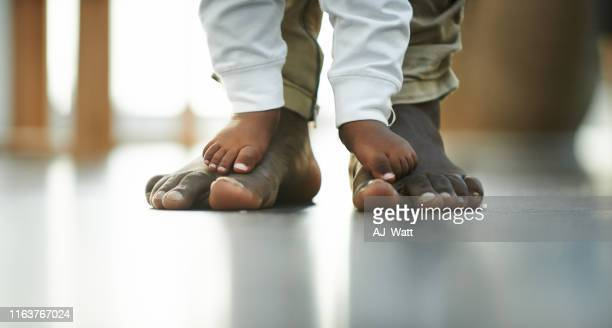 raise them to stand on their own two feet - barefoot black men stock pictures, royalty-free photos & images
