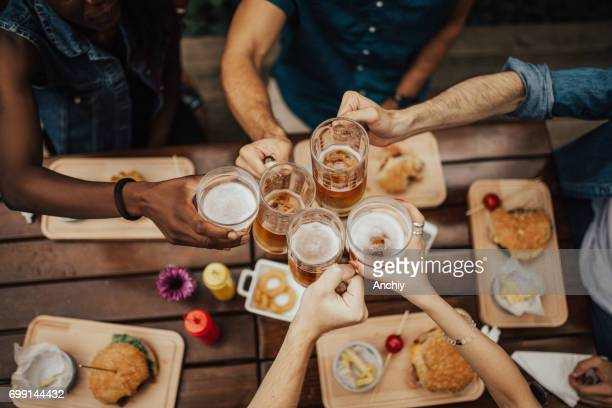 raise your glasses for a toast. - barbecue social gathering stock pictures, royalty-free photos & images