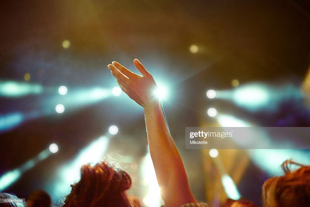 Raise your hands if you're having an awesome time : Stock Photo
