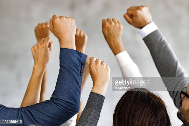 raise your hands in protest! - striker stock pictures, royalty-free photos & images