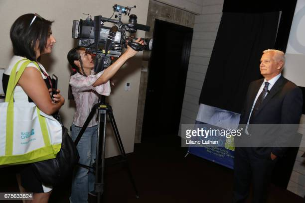 RaiseAChild Founder and CEO Rich Valenza gets interviewed by media at the reveal of the RaiseAChild's 'Reimagine Foster parents' campaign at...