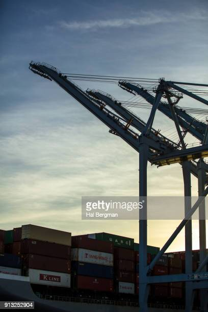 Raised Crane Booms and Shipping Containers