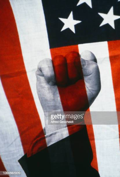 A raised fist superimposed over an American flag 1982
