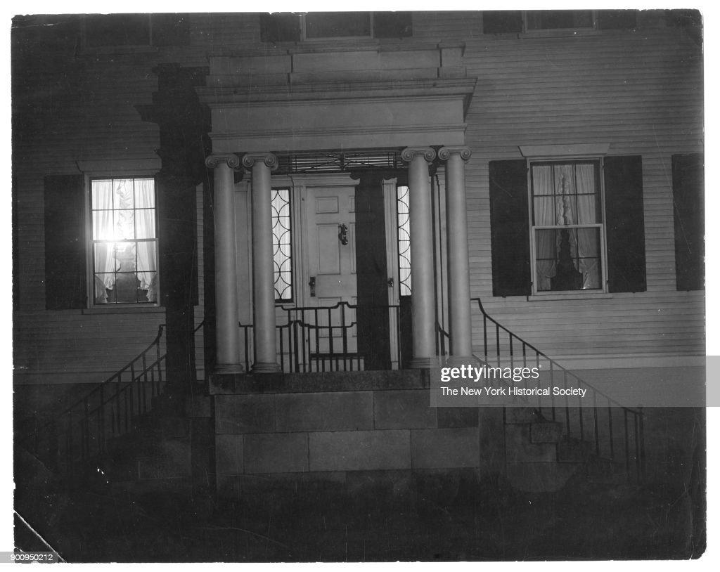 Raised front stoop and front door of home with two columns flanking door metal & Boston Doorway Pictures   Getty Images