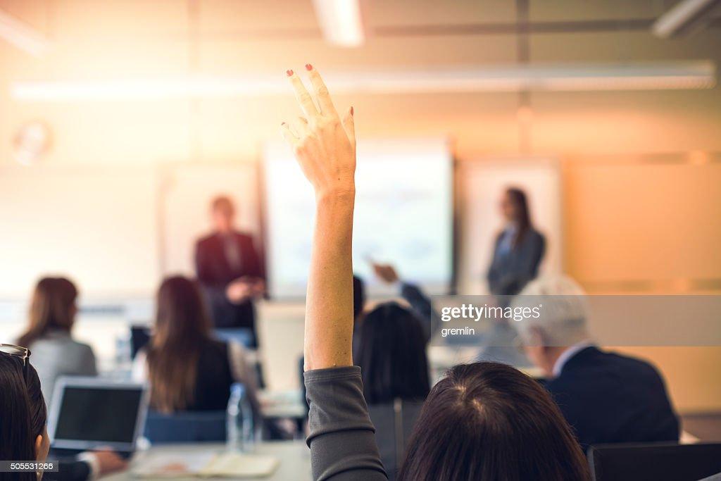 Raised hand, business seminar, education : Stock Photo