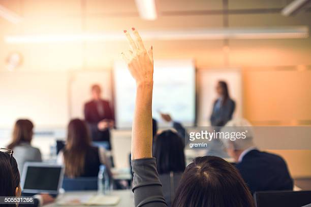Raised hand, business seminar, education