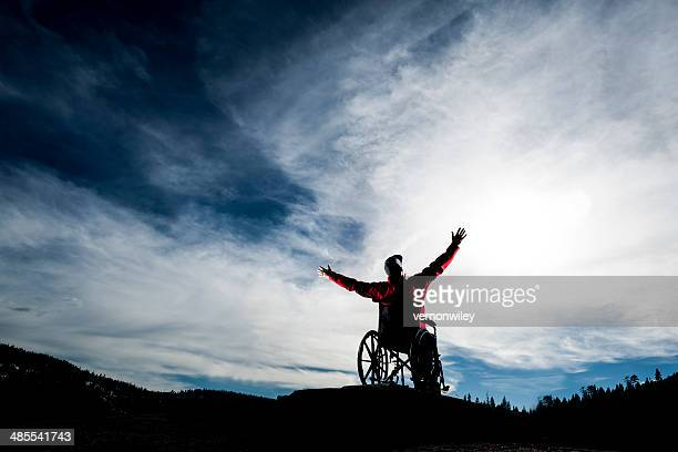 raised hands - paraplegic stock photos and pictures