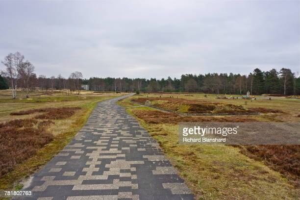 Raised mounds marking some of the thirteen mass graves at the site of the former BergenBelsen German Nazi concentration camp in Lower Saxony Germany...