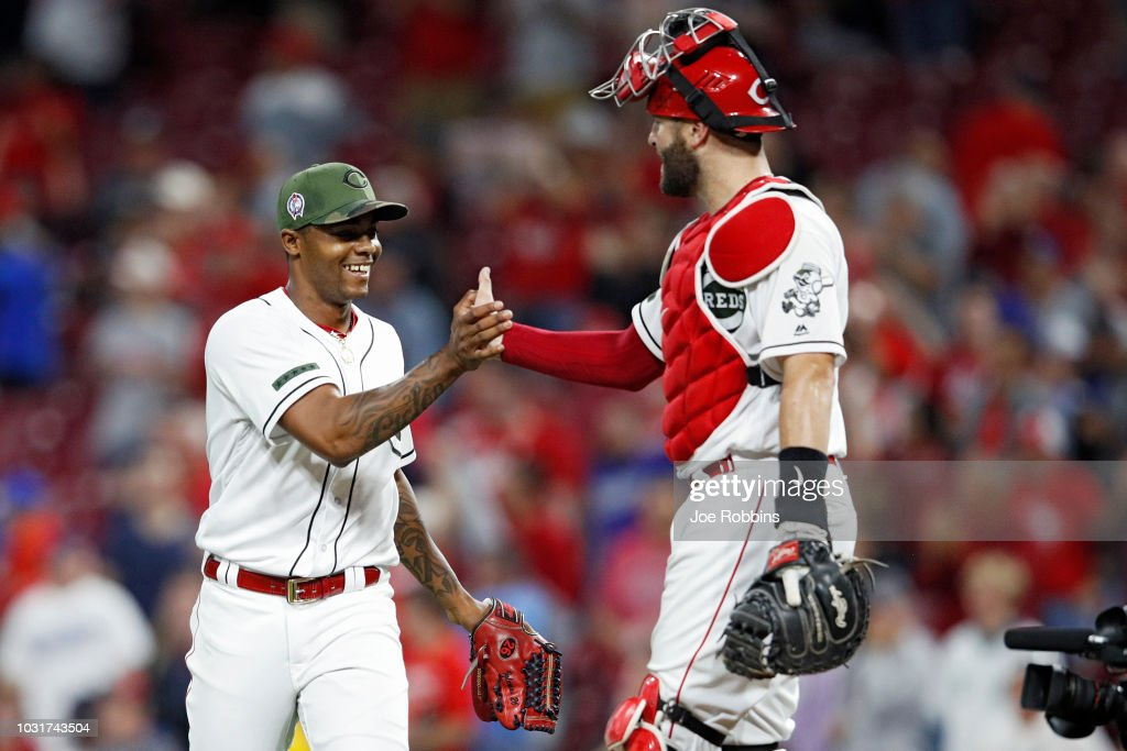 Raisel Iglesias #26 and Curt Casali #38 of the Cincinnati Reds celebrate after the final out in the ninth inning of the game against the Los Angeles Dodgers at Great American Ball Park on September 11, 2018 in Cincinnati, Ohio. The Reds won 3-1.