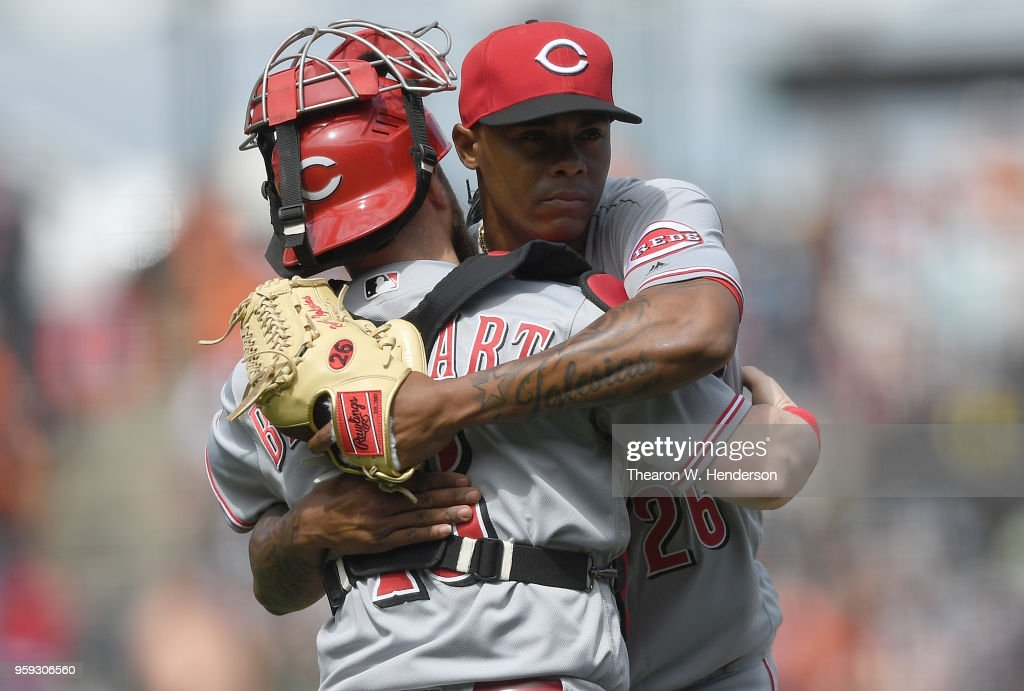 Raisel Iglesias #26 and Tucker Barnhart #16 of the Cincinnati Reds celebrates after they defeated the San Francisco Giants 6-3 at AT&T Park on May 16, 2018 in San Francisco, California. The Reds won the game 6-3.