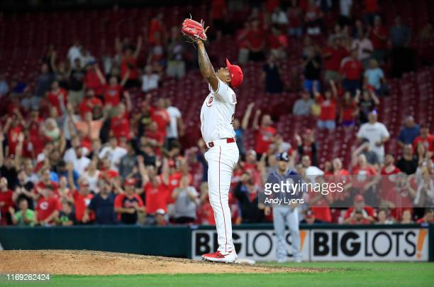 Raisel Iglesias of the Cincinnati Reds celebrates after the final out of the 32 win against the San Diego Padres at Great American Ball Park on...