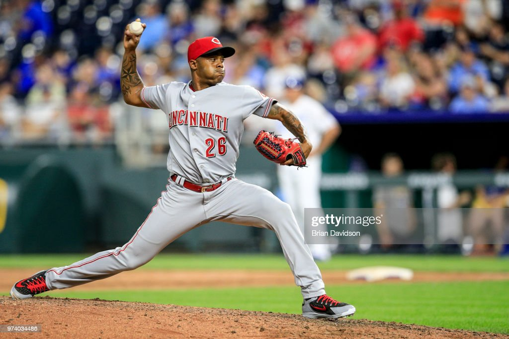 Raisel Iglesias #26 of the Cincinnati Reds pitches against the Kansas City Royals during the ninth inning at Kauffman Stadium on June 13, 2018 in Kansas City, Missouri.