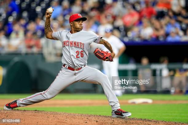 Raisel Iglesias of the Cincinnati Reds pitches against the Kansas City Royals during the ninth inning at Kauffman Stadium on June 13 2018 in Kansas...