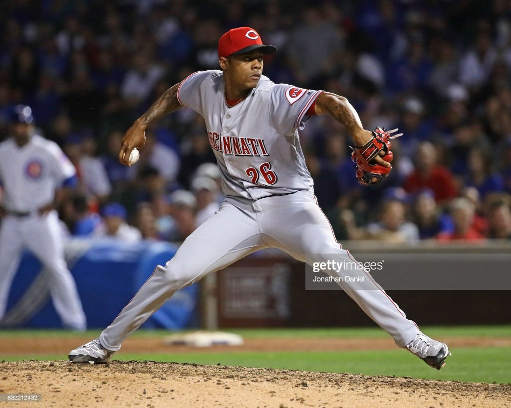 Raisel Iglesias #26 of the Cincinnati Reds pitches in the 9th inning for a save against the Chicago Cubs at Wrigley Field on August 15, 2017 in Chicago, Illinois. The Reds defeated the Cubs 2-1.