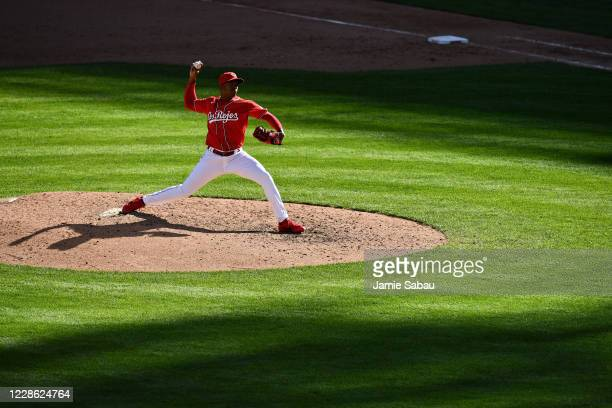 Raisel Iglesias of the Cincinnati Reds pitches in the ninth inning to close out a 7-3 victory over the Chicago White Sox at Great American Ball Park...