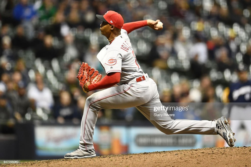 Raisel Iglesias #26 of the Cincinnati Reds throws a pitch during the ninth inning of a game against the Milwaukee Brewers at Miller Park on April 16, 2018 in Milwaukee, Wisconsin.