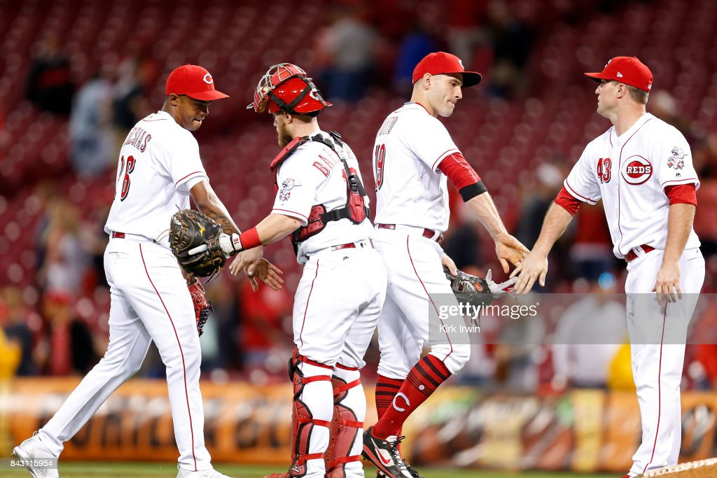 Raisel Iglesias #26, Tucker Barnhart #16, Joey Votto #19, and Scott Schebler #43, all of the Cincinnati Reds congratulate each other after defeating the Milwaukee Brewers 9-3 at Great American Ball Park on September 5, 2017 in Cincinnati, Ohio.