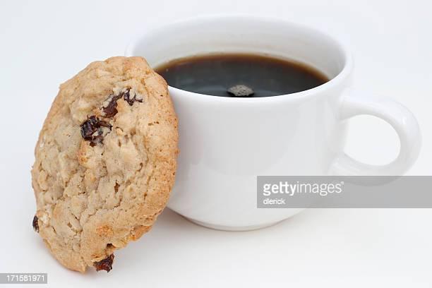 raisin oatmeal cookie leaning against coffee cup