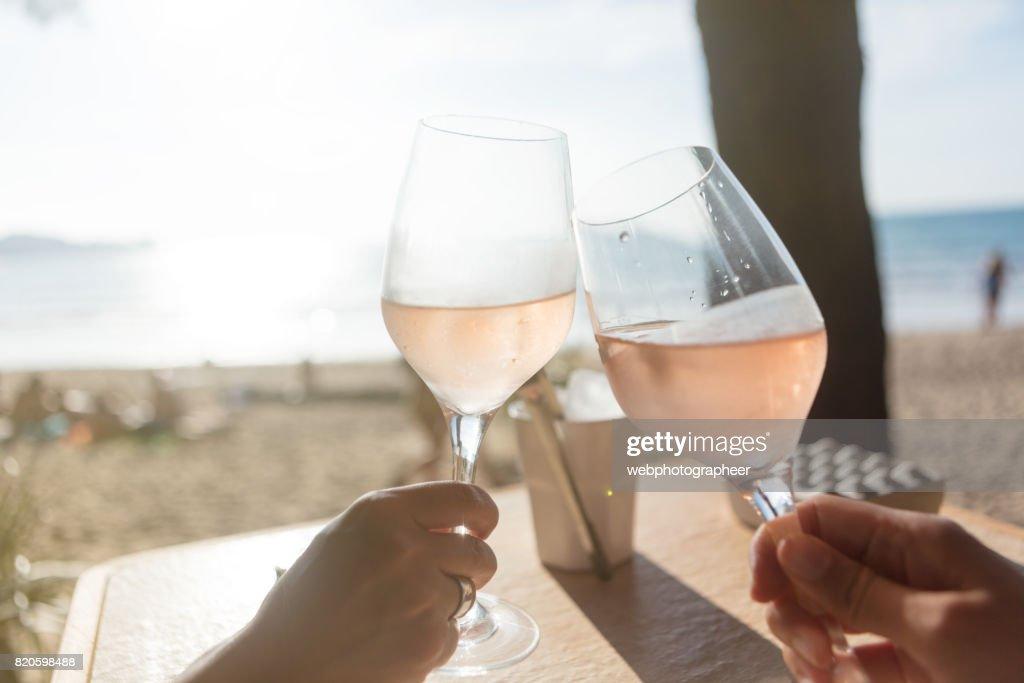 Raising a glass : Stock Photo