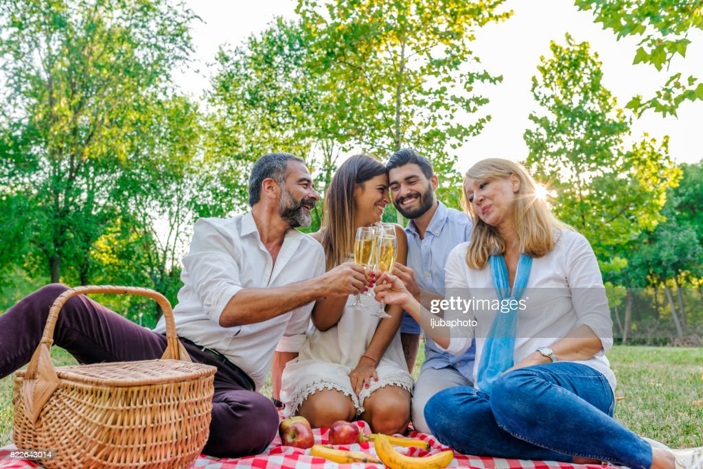 Raising a glass : Stock Photo