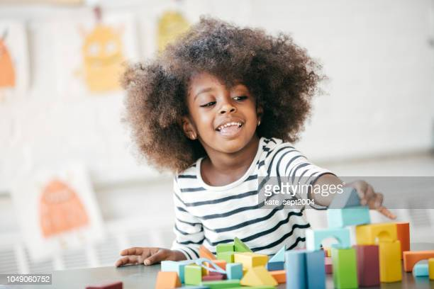 raising a happy and confident child - preschool stock pictures, royalty-free photos & images