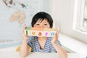 boy holding blocks