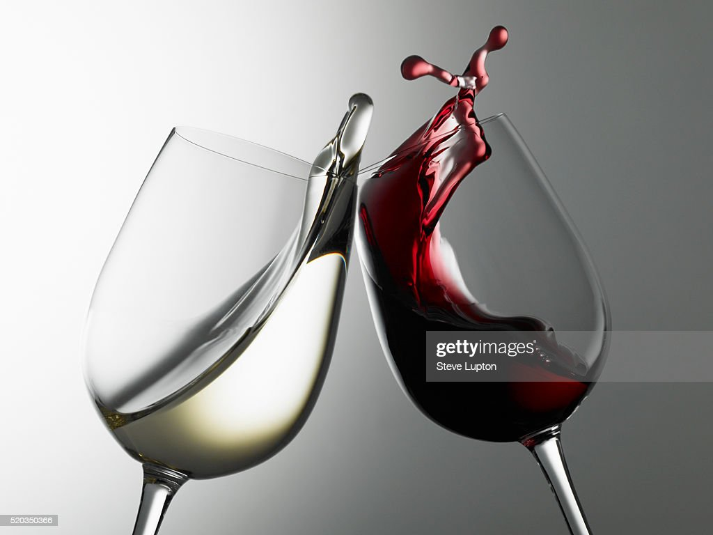 Raising a toast of red and white wines : Stock Photo