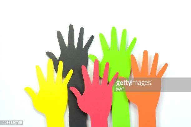 raising hands - democracy stock pictures, royalty-free photos & images